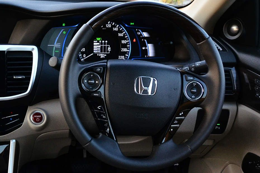 New Honda Accord Gripping Steering Wheel